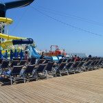 chairs near slide carnival cruise